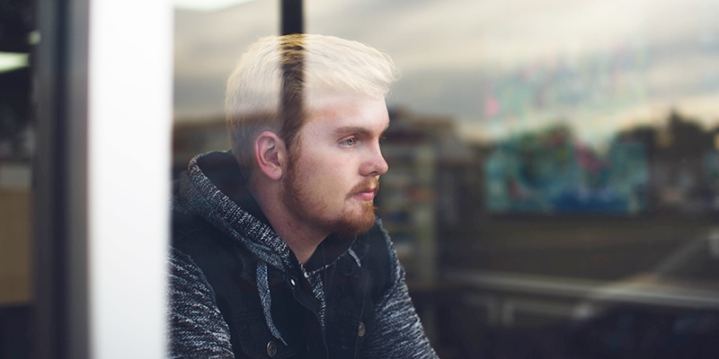 Man pensively thinking about the unexpected change in his life