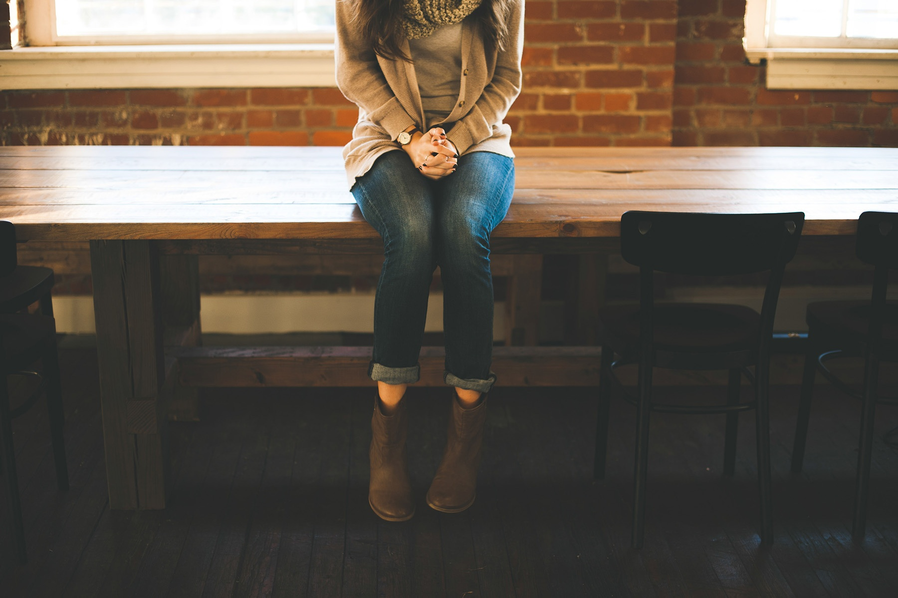 Girl sitting on a desk alone